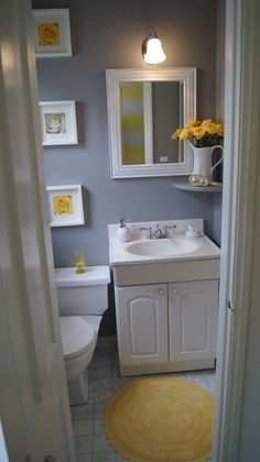 Downstairs Powder Room , One of my favorite color combinations is grey, yellow and white which of course gives it the clean crisp look that I love.
