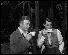 """Co-stars Claude Rains and Cary Grant having tea between scenes on the set of """"NOTORIOUS"""", directed by Alfred Hitchcock. Golden Age Of Hollywood, Vintage Hollywood, Hollywood Stars, Classic Hollywood, Hollywood Hills, Vintage Vogue, Cary Grant, Classic Movie Stars, Classic Movies"""