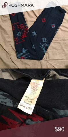 Hard to find Aztec Lularoe OS leggings Hard to find Aztec Lularoe OS leggings.   Navy with burgundy and light blue.  New, bundle for additional discount or Make me an offer!!!!! LuLaRoe Pants Leggings
