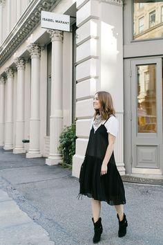 Black dress over a white tee with a bandana.