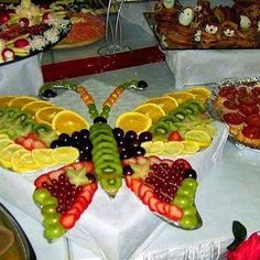Butterfly fruit tray--I don't usually like fruit arrangements, but this is pretty. Fruit Plate, Fruit Art, Fruit Trays, Fun Fruit, Fresh Fruit, Fruit Buffet, Baby Fruit, Fruit Food, Colorful Fruit