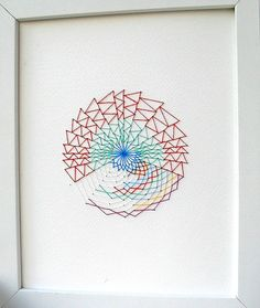 Geometric hand embroidered artwork. Cross stitch on paper, colourful cotton thread. 8x10 inches. Original textile design by Rachel Parker.