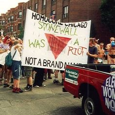 """""""HOMOCORE CHICAGO--STONEWALL WAS A RIOT, NOT A BRAND NAME,"""" Homocore Chicago contingent, Chicago Pride Parade, Chicago, Illinois, June 5, 1994. Photo c/o The Queer Zine Archive Project. In 1994, organizers of Chicago's Pride events rescheduled the city's festivities, moving them from the traditional last weekend of June to the first weekend of June in order to accommodate those who wanted to travel to New York City to celebrate the twenty-fifth anniversary of the Stonewall Riots. Homocore…"""