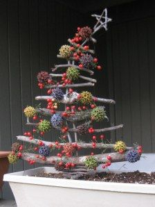Twig Christmas tree decorated with Sweet Gum balls, think I would do it with colored glitter spray