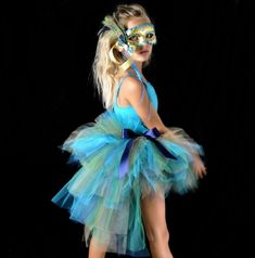 This peacock inspired bustle tutu is stunning in shimmering gold turquoise navy and emerald green tulle When I decided to design the peacock tutu the first thing that came to