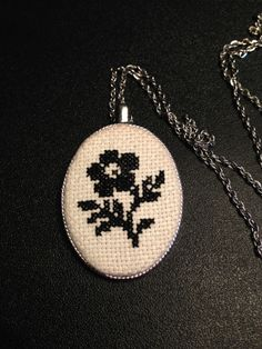 A while ago, I picked up a blank pendant to put a cross stitch piece in. It took me forever to decide what to put in it, because it had to be small. In the end, I decided to put something plain and… Small Cross Stitch, Cross Stitch Art, Beaded Cross Stitch, Crochet Cross, Cross Stitch Flowers, Cross Stitch Designs, Cross Stitching, Cross Stitch Embroidery, Cross Stitch Patterns
