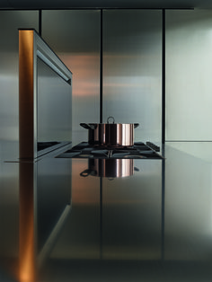 Varenna_PHOENIX_Personalised Downdraft hood Varenna integrated in the worktop in steel and black glass