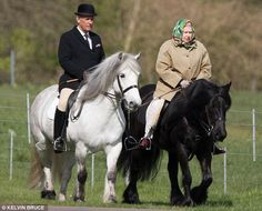 Out for a ride: The Queen enjoys the sunshine in Windsor accompanied by her stud groom Terry Pendry