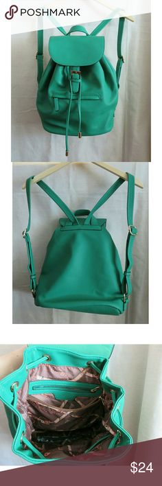 """Irish Green Drawstring Backpack Purse Diaper Bag +Like new, used once or twice, bought new at TJ Maxx. Medium sized drawstring backpack purse, great from work to everyday or as a diaper bag! Vegan/ faux pebbled leather, structured bottom, 5 interior pockets, 1 exterior. Kelly/Irish green w/gold accents and bronze equestrian print lining. Measures 11.5"""" long at bottom, 12"""" across the top. 14"""" tall, 6.5"""" deep base, 8"""" & 6.5"""" inside zip pockets, straps extend to 31"""". +Bundle with my other…"""