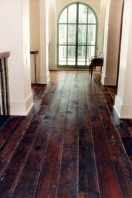 These are beautiful floors - but what I marvel at is the clear floor and a hallway nonetheless: amazing. This must be an empty/show house!