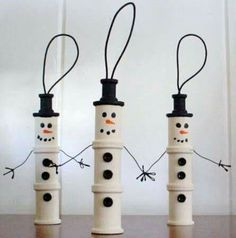 Use empty thread spools to create little snowmen ornaments!