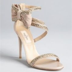 "Valentino Garavani nude/blush heels w/gold chain Valentino women's blush/nude chain link trimmed suede bow detail heels.  Patent covered heel with rear zip closure. Rounded open toe. Soft suede upper with varied chain link trim.  Leather lined with patent inset at toe. Leather sole. Chain link trimmed bow detail at side. 4"" patent covered heel.  Wore once for wedding photos.  can still see the sticker of original price $1400.  In perfect flawless condition.  Runs big, although size 5/35…"