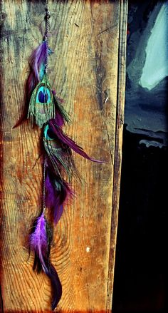 Extra Long Single Feather Chain Earring OR Feather Hair Clip, Extension-18 inches long-Feather Symbolism. $29.00, via Etsy.-love the colors!