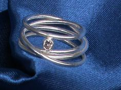 An endless coil of sterling silver set with a champagne cubic zirconia. Types Of Gemstones, Birthstones, Infinity, Heart Ring, Sterling Silver, Rings, Etsy, Jewelry, Infinite