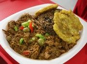 Ropa vieja at Havana's Pilon is shredded beef cooked with tomato sauce and vegetables, served with congri rice (rice with black beans) and tostones (fried green plantains). (Mike Maple, The Commercial Appeal)