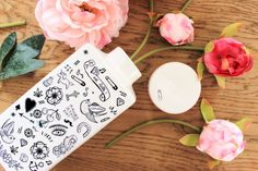Use temporary tattoos to update a plain vase.