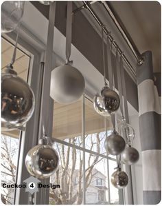coffee table christmas decorations | also hung some more Christmas balls into the window of our dining ...
