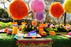lorax themed birthday party featured brightly colored truffala trees on the dessert table