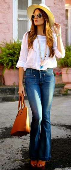 Casual jeans outfit with white top, hat, sunglasses and tan bag. What to wear this fall winter 2014 - main trends