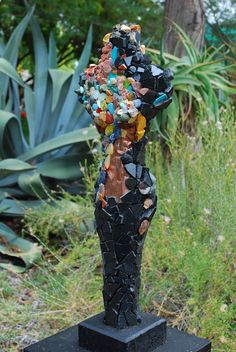 mosaic figure in a garden