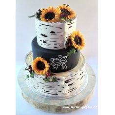 Wedding cake with suflowers from sugarpaste and efect of birch tree's bark.