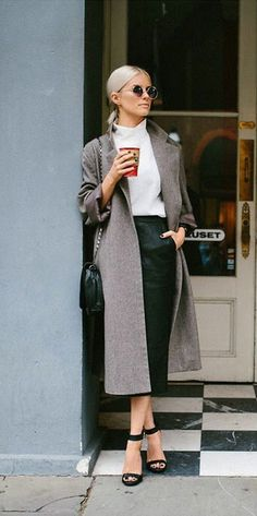Gray overcoat, leather skirt, and open toe heel make for the perfect ensemble.