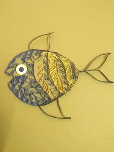 Paper quilled fish artwork