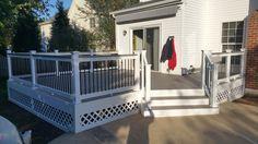 A beautiful Deck with Trex Decking, Vinyl Railings, Black Balusters, Vinyl Trim Wrap, Vinyl Lattice, and Deck Lights in Leesburg, Virginia.