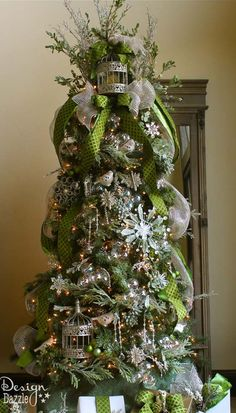 Michaels Dream Tree Challenge 2013. This years tree is all about jade, apple, mint and silvery sage! Iridescent ornaments, silver glittered accents, baubles, birds, moss and more make this tree the JEWELED FOREST! Tree designed by Toni @Design Dazzle #JustAddMichaels