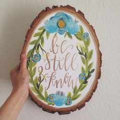 "Hand lettered Wood Slice | Blue Floral Wreath Painting | Wooden Slice Artwork | ""Be Still & Know"" Modern Calligraphy by AngelaDavidsonDesign on Etsy https://www.etsy.com/listing/229838164/hand-lettered-wood-slice-blue-floral"