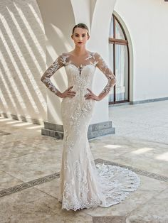 The Kate gown achieves the perfect balance between timeless elegance and modern sexiness: a plunging illusion sweetheart neckline is complemented with full-length illusion sleeves for coverage and an ...