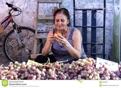 A Woman Is Eating Peach At The Bazaar Editorial Photo - Image: 99696011