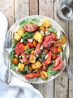 Heirloom Tomato Cornbread Salad Recipe - easy, fresh, delish! Heirloom tomatoes, homemade cornbread, white balsamic, olive oil, & shaved Parmesan on baby arugula.  #tomatoes http://tasteandsee.com via @h_tasteandsee