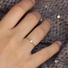 Pear Diamond Engagement Ring; simple and delicate. Made in 14k yellow gold with a beautiful pear cut diamond. Pairs nicely with our other skinny rings. Additional Details: • Bezel-set diamond; carat t