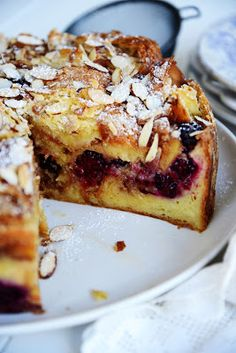 Oh my darling, I know we've never met before but I feel as though we know each other so well.  Your moist texture, sweet berries, and the delectable crunch of your almond topping- could it be that this is love at first sight?  Shall we dine and find out?