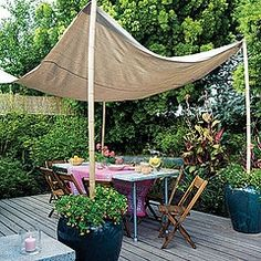 Removable drop cloth as a canopy. I would definitely add some interest by drawing or adding a stencil design.