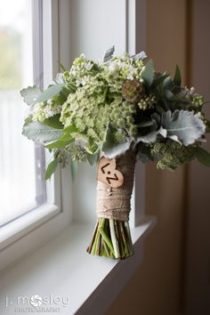 succulent, queen anne's lace, scabiosa pods, dusty miller bouquet with burlap and engraved heart