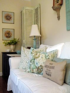 aqua-accented living room, as well as French country charm in the distressed shutters and weathered decor