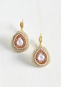 If accessorizing were a game, you'd win with these golden earrings! Within their teardrop pendants, white chains, pink beads, amber rhinestones, and rose-tinted faux gems team up to shine with stylish success.
