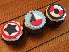nautical themed baby shower cupcakes - cupcakes with fondant decorations made to match shower theme