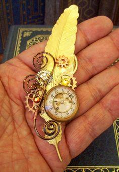 Steampunk Hat Pin or Brooch (HA33) - Raw Brass Feather - Glass Clockface Cabochon - Gears - Swarovski Crystals. $ 34.00, via Etsy.