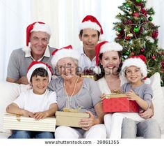 stock photo : Happy family holding Christmas presents at home