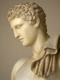 Statue of Hermes. Coarse-grained white marble. Roman copy.