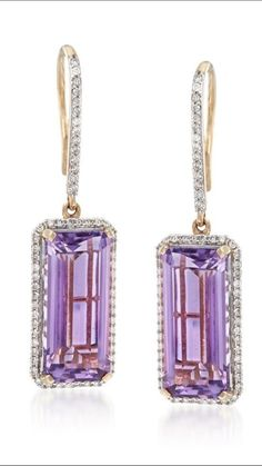"Amethyst and Diamond Drop Earrings in 14kt Yellow Gold. Here's a delightful pair that dangles. Sophisticated emerald-cuts of 14.00 ct. t.w. Amethyst are iced in .62 ct. t.w. Diamond rounds. Set in polished 14kt yellow Gold. Hanging length is 1 1/2"". •€1,373.38"