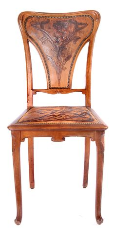 Set of 6 Jugendstil Chairs, c. 1900, carved, with tooled leather floral upholstery.