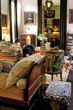 Wonderful textiles & patina in this beautifully cluttered, eclectic living room