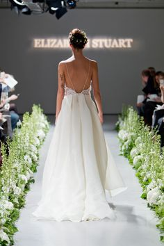 Beautiful backless wedding dress with spaghetti straps and full tulle skirt.  Elizabeth Stuart ~ The Enchantment of The Seasons Fall/Autumn 2014 Bridal Wear Collection.  Photographed by Catherine Mead http://photographybycatherine.co.uk/ for Elizabeth Stuart http://www.elizabeth-stuart.com/