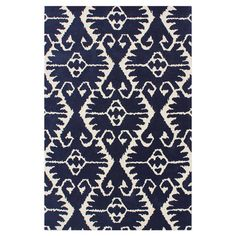 Royal blue and ivory wool rug with a tribal trellis motif. Hand-tufted in India.  Product: RugConstruction Material:...