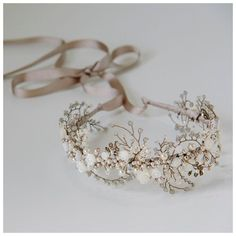 Beautiful floral crown headdress made from an abundance of Mother of Pearl carved roses, petals, freshwater pearls, Swarovski glass pearls and crystals and tiny glass Miyuki Delica seed beads intricately and meticulously hand wired in beautiful shades of ivory, cream and taupe. This design is symmetrical and can be worn across your forehead or pushed back onto your head. The design has been wired onto a lightweight, narrow headband that can be covered in a ribbon colour to match you...
