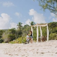 This surprise proposal on a secluded stretch of beach in St. Thomas might be the most romantic proposal ever! (Photos by Rouxby)